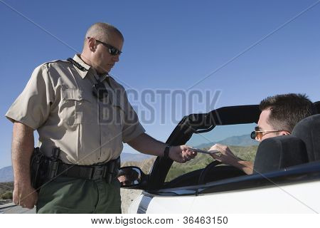 Traffic officer checking a driver's license