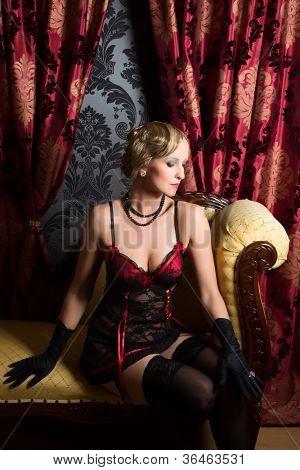 Retro boudoir room and sexy woman wearing twenties style corset