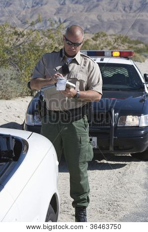 Traffic officer in uniform writing ticket