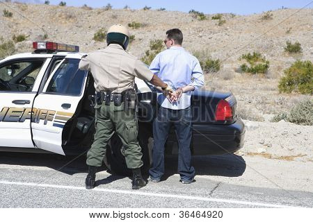 Policeman arresting somebody