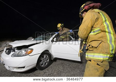 Firefighters at the site of car accident