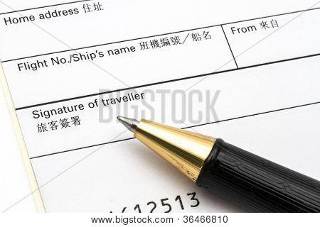 Arrival card and pen closeup