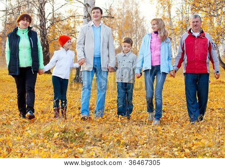 Families with children and grandparents in autumn park. Big family