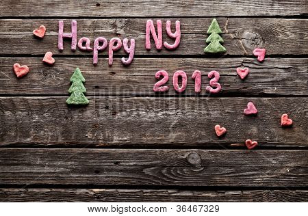 Sweet 2013 New Year holiday background. With small hearts and cute small Christmas trees.