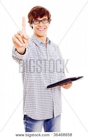 Smiling latin college student with tablet PC showing forefinger. Isolated on white background, mask included