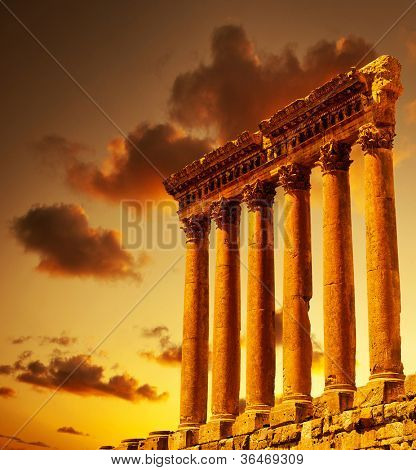 Column ruins over sunset, ancient lebanese building, Heliopolis Baalbek columns in Lebanon, arabian aged landmark, famous temple monument, travel, vacation, tourism concepts