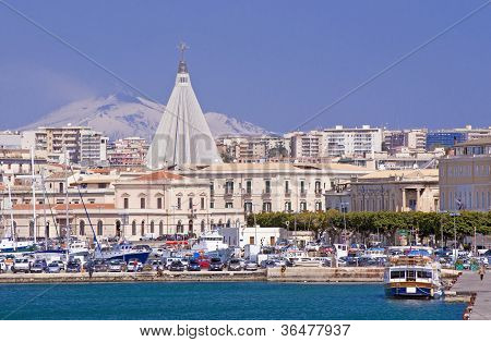 Harbour Of Siracusa With Etna Volcano In Background