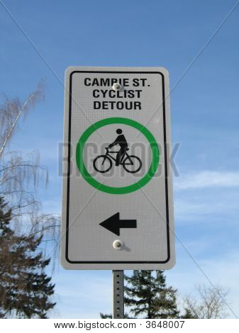 Cyclist Detour Sign Against A Blue Sky