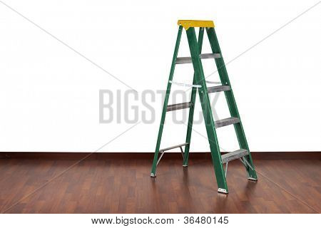 Ladder in interior wooden floor and white wall