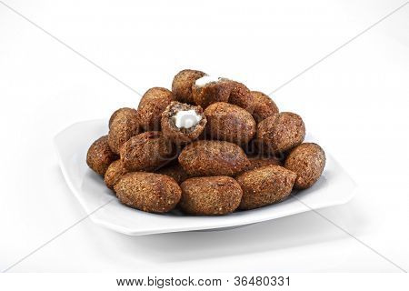 Kibe - delicious fried meat cakes as appetizer .