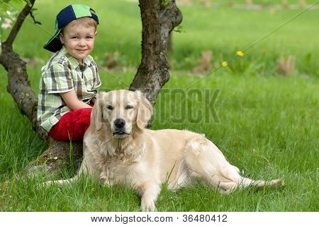 A little boy and dog on garden