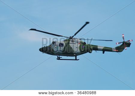 EASTBOURNE, ENGLAND - AUGUST 11: A Westland Lynx AH.7 multi purpose helicopter of the Army Air Corps performs at the Airbourne airshow on August 11, 2012 at Eastbourne, East Sussex.
