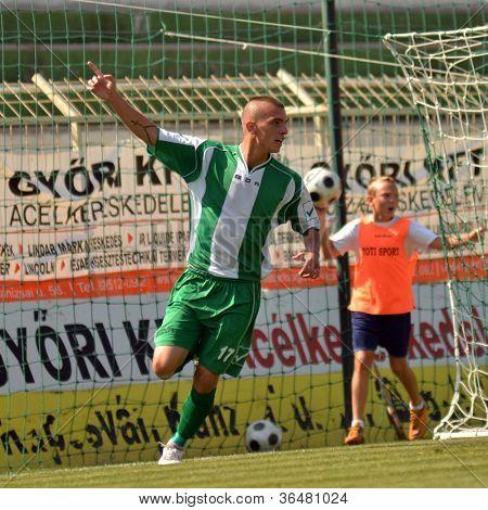 KAPOSVAR, HUNGARY - AUGUST 26: Patrik Bojte celebrates goal at a Hungarian Championship II. soccer game Kaposvar II. (green) vs. Paks II. (claret) August 26, 2012 in Kaposvar, Hungary.
