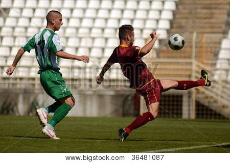 KAPOSVAR, HUNGARY - AUGUST 26: Patrik Bojte (in green) in action at a Hungarian Championship II. soccer game Kaposvar II. (green) vs. Paks II. (claret) August 26, 2012 in Kaposvar, Hungary.