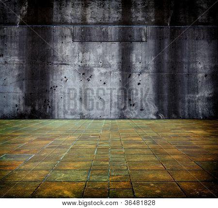 Grande muro de concreto e piso.