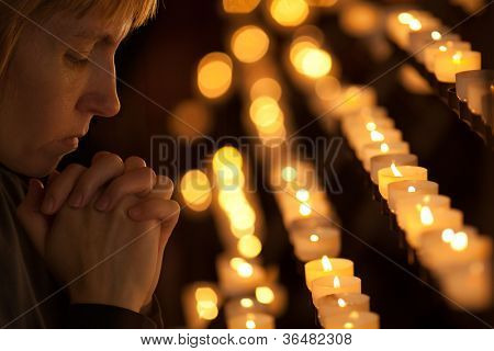 Woman praying in Catholic church