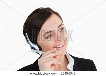 Businesswoman in black suit using a headset against white background