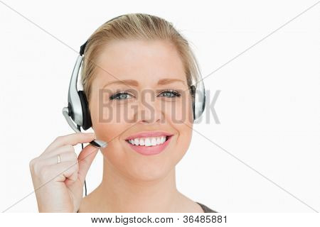 Woman working in a call center against white background