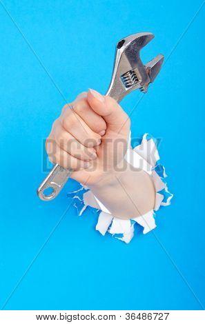Hand holding chrome wrenh