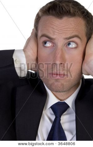 Businessman With Hands On His Ears