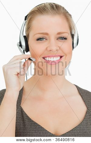 Smiling woman working in a call center against white background