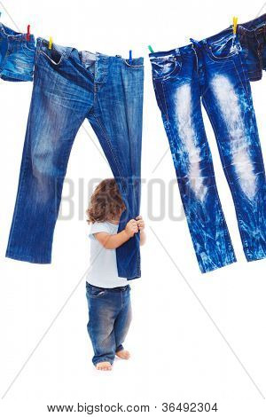 Toddler pulling denim clothes, isolated