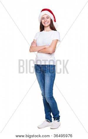 full length portrait of pretty woman in santa hat looking at camera and smiling. studio shot over white background