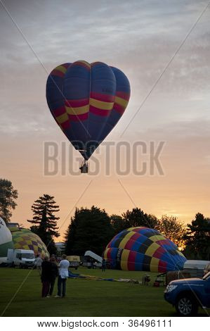 NORTHAMPTON, ENGLAND - AUGUST 18: Hot Air Balloons launching and inflating at the Northampton Balloon Festival, on August 18, 2012 in Northampton, England.