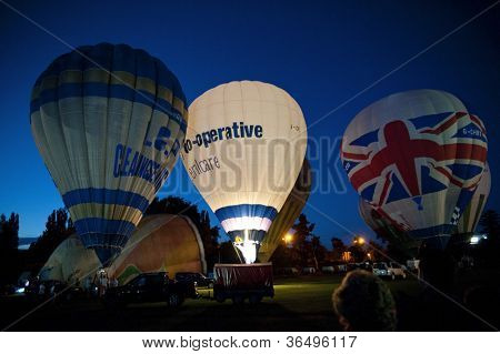 NORTHAMPTON, ENGLAND - AUGUST 18: Hot Air Balloons demonstrating night time glows at the Northampton Balloon Festival, on August 18, 2012 in Northampton, England.