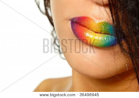 Young mulatto fresh woman with rainbow vivid color lips. Isolated on white background