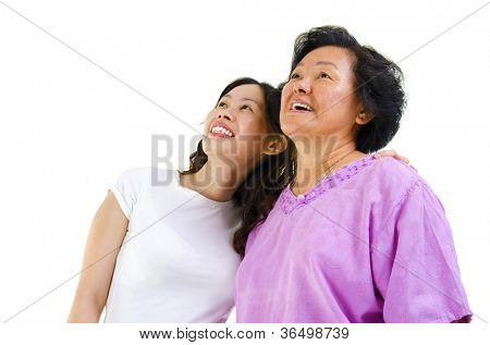Senior Asian woman and young daughter looking away with smiling, on white background.