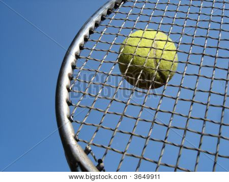 Tennis Ball Hits Racket