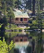 stock photo of log cabin  - cabin in the woods near lake
