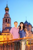 husband wife hug near Alexander Nevsky church in Vologda, Russia, long exposure