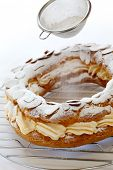foto of brest  - sifting powdered sugar over a paris brest - JPG