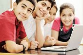 stock photo of muslim kids  - Happy children smiling and laughing in the classroom - JPG