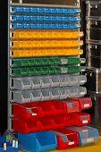 image of shelving unit  - Colourful plastic bin trays at open shelf - JPG