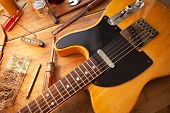 picture of fret  - Guitar on guitar repair desk - JPG