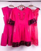 stock photo of matron  - The pink dress on a hanger in the closet - JPG
