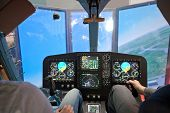 Two guys  flying on helicopter simulator