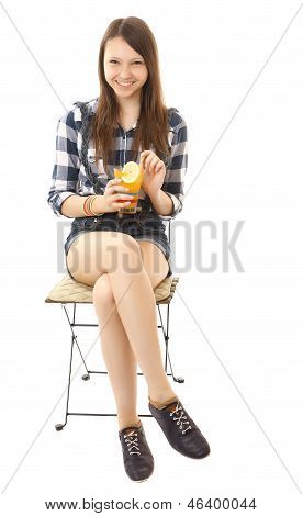 Girl Teenager, Caucasian Appearance, Brunette, Wearing A Plaid Shirt And Short Denim Shorts, Holding