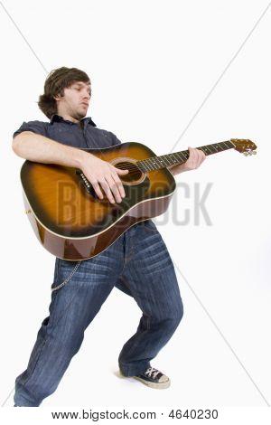 Passionate Guitarist Playing His Guitar