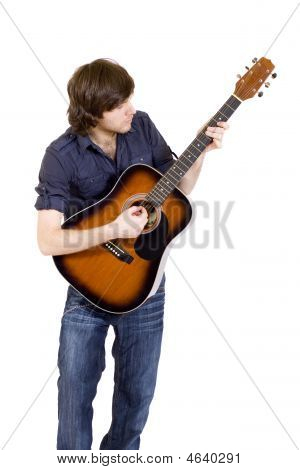 Picture Of A Guitarist Playing His Acoustic Guitar