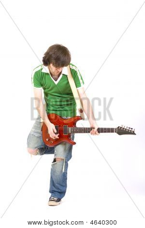 Iguitarist Playing His Guitar One Leg Up