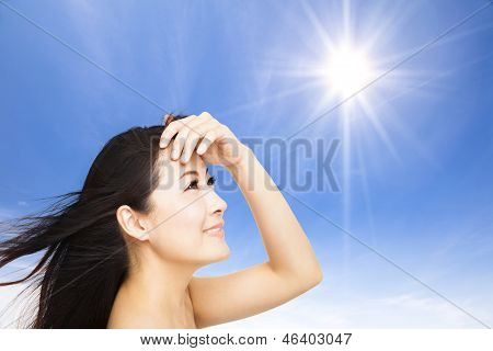 Beautiful Young Woman With Sunlight Background. Summer Skin Care Concept