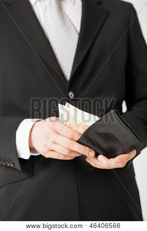 picture of man hands with purse counting euro cash money
