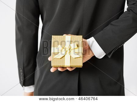 close up of man hands holding gift box