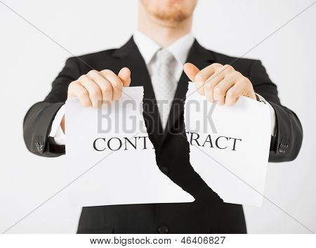 picture of man hands tearing contract paper