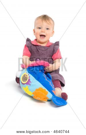 Baby Girl Playing With Toy - Isolated