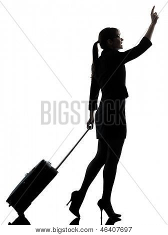 one business woman traveler walking hailing silhouette studio isolated on white background